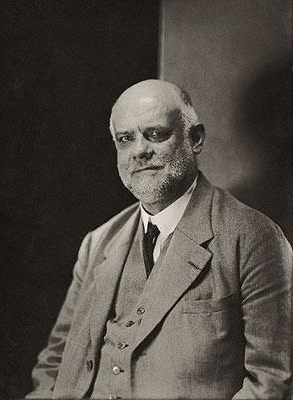 French Biographer Ambroise Vollard...ca. 1930 --- French biographer, lawyer, and art collector, Ambroise Vollard, with a bald cranium and gray beard, wearing a gray suit. --- Image by Cond Nast Archive/CORBIS